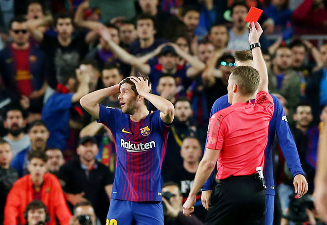 Barcelona's Sergi Roberto is shown a red card by referee Alejandro Hernandez during the Clasico against Real Madrid at Camp Nou on Sunday
