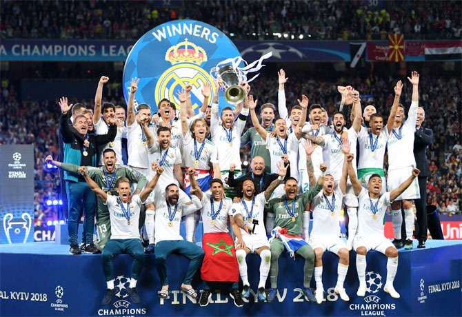 Real Madrid players celebrate with the trophy after defeating Liverpool 3-1 to win the UEFA Champions League final in May 2018