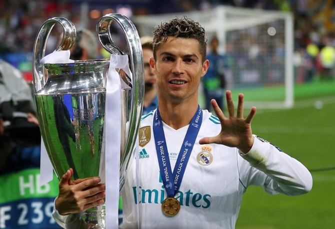 Real Madrid's Cristiano Ronaldo gestures as he celebrates winning the Champions League against Liverpool in May
