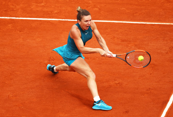 Romania's Simona Halep plays backhand during first round match against United States' Alison Riske