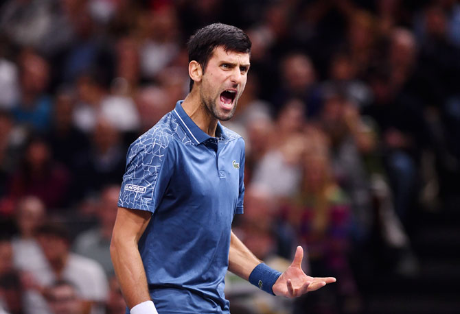 Serbia's Novak Djokovic reacts during his match against Karen Khachanov