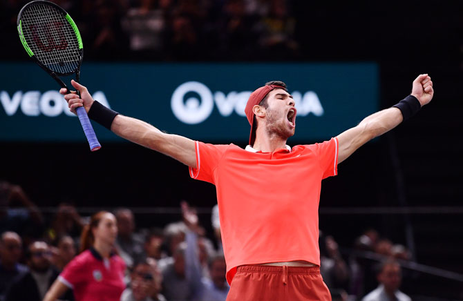 Russia's Karen Khachanov celebrates after defeating Serbia's Novak Djokovic to win the Paris Masters on Sunday