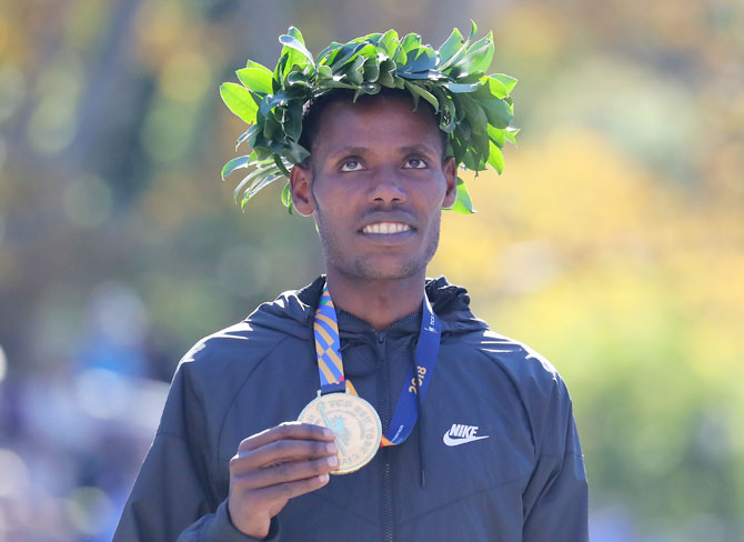Ethiopia's Lelisa Desisa poses with his first place medal at the finish line after winning the 2018 TCS New York City Marathon in Central Park in New York City on Sunday