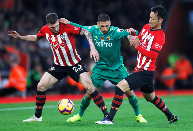 Southampton's Pierre-Emile Hojbjerg and Maya Yoshida challenge Watford's Jose Holebas(centre) during their match at St Mary's Stadium