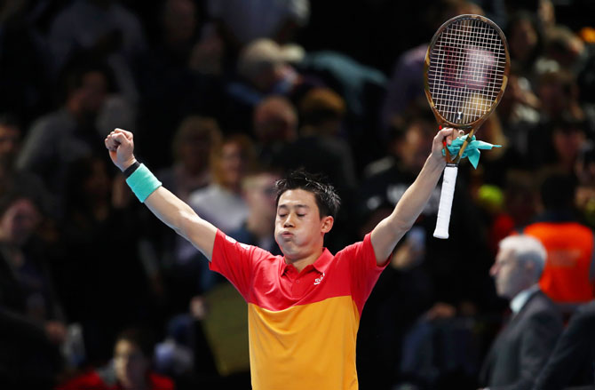 Japan's Kei Nishikori celebrates after defeating Swiss Roger Federer in the ATP Tour Finals opener at O2 Arena in London on Sunday