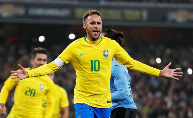 Brazil's Neymar celebrates after scoring the winner from the penalty spot