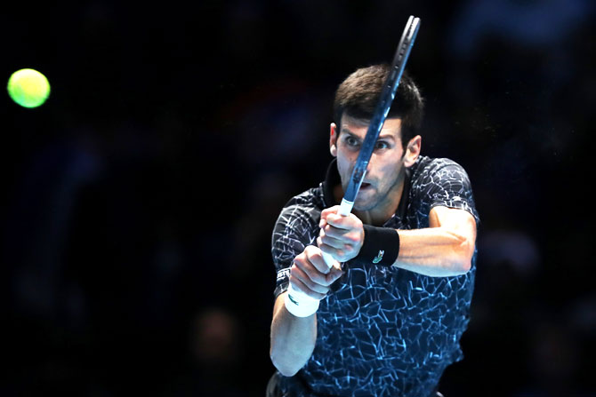 Serbia's Novak Djokovic plays a backhand during his singles final against Germany's Alexander Zverev