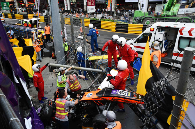 Rediff Sports - Cricket, Indian hockey, Tennis, Football, Chess, Golf - F3 driver Floersch fractures spine after huge airborne crash