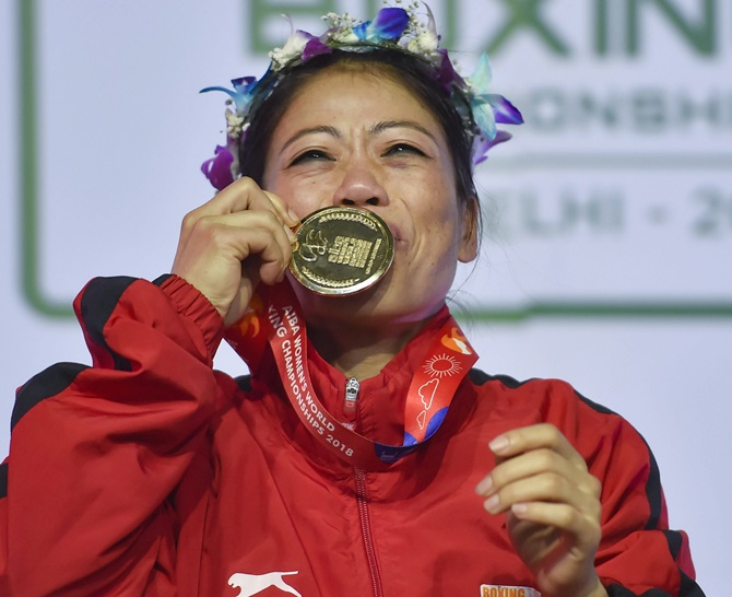 Mary Kom kisses her medal after she won gold in the Women's World Championships, November 24, 2018. Photograph: Ravi Choudhary/PTI