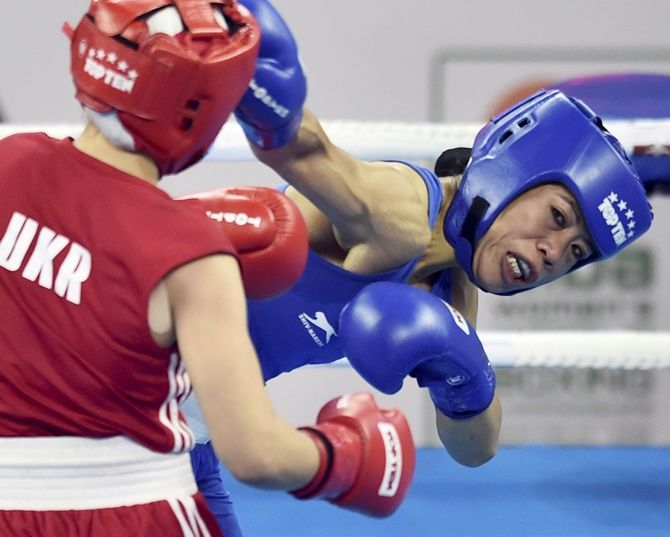 Mary Kom in action against Ukraine's Hanna Okhota during the AIBA Women's World Boxing Championships 48kg category final. Photograph: Ravi Choudhary/PTI