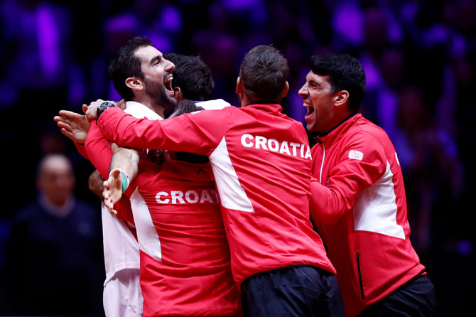 Team Croatia celebrate winning the Davis Cup after Marin Cilic beat France's Lucas Pouille on Sunday