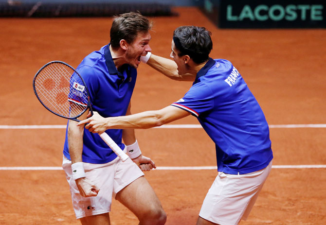 France's Pierre-Hugues Herbert and Nicolas Mahut celebrate winning their doubles match against Croatia's Ivan Dodig and Mate Pavic during the Davis Cup final at Stade Pierre Mauroy in Lille, France, on Sunday