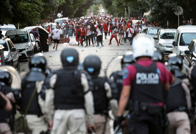 River Plate's fans clash with riot police after the match betweeb River Plate and Boca Juniors was postponed in Buenos Aires in Argentina on Sunday