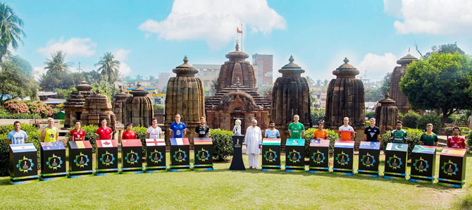 Captains of the teams participating in the Hockey World Cup join Odisha Chief Minister Naveen Patnaik for a picture at Mukteshwar Temple, in Bhubaneswar on Monday
