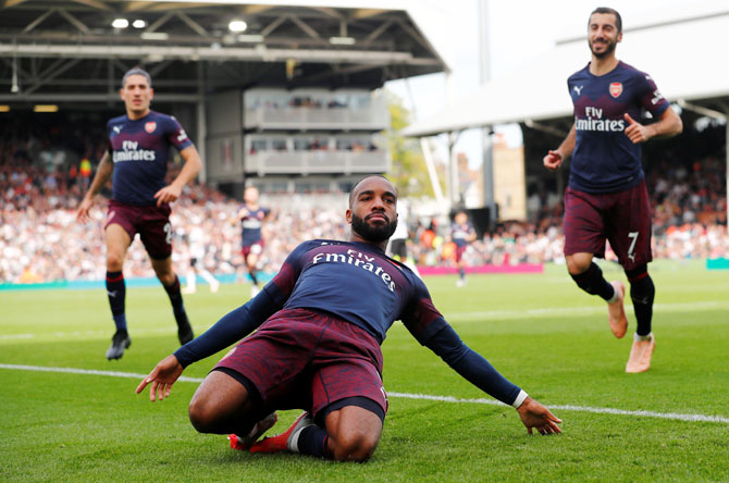 Arsenal's Alexandre Lacazette celebrates scoring their second goal against Fulham during their EPL match at Craven Cottage in London on Sunday