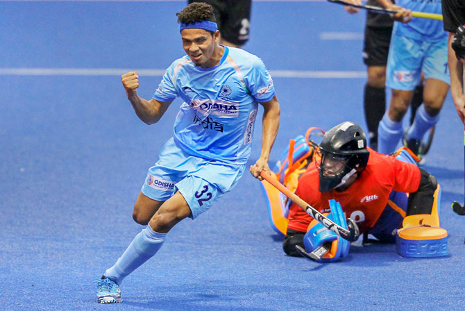 India's Shilanand Lakra celebrates after scoring a goal against New Zealand in the 8th Sultan of Johor Cup hockey tournament in Johor Bahru, Malaysia, on Sunday