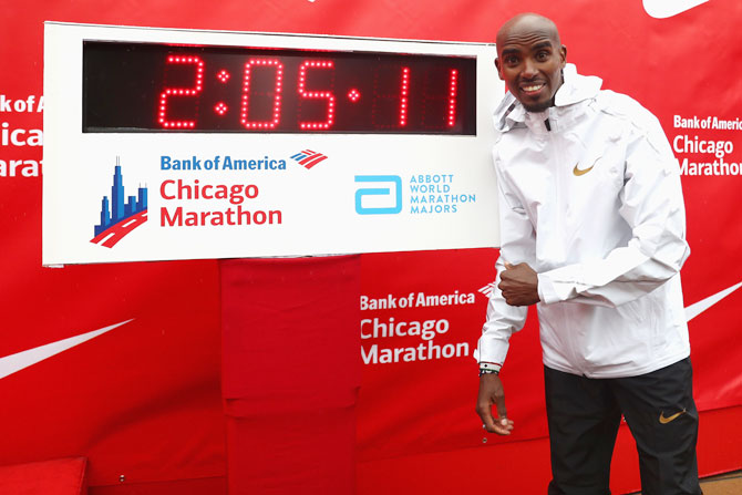 Great Britain's Mo Farah celebrates winning the men's race setting a new European record in 2 hours,five minutes and 11 seconds during the 2018 Bank of America Chicago Marathon in Chicago, Illinois, on Sunday