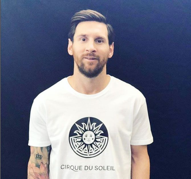 Lionel Messi dons a T-shirt to announce the show to be performed by Cirque du Soliel