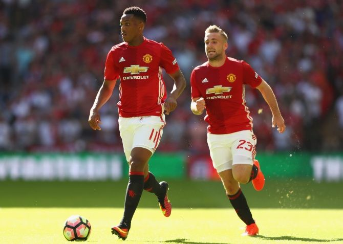 Manchester United's Anthony Martial, left, and Luke Shaw