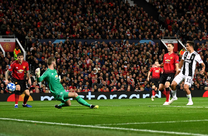 Paulo Dybala beats Manchester United Goalkeeper David de Gea to scores Juventus's goal, a Champions League game ManU lost 1-0, October 22, 2018. Photograph: Michael Regan/Getty Images