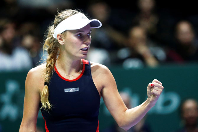 Caroline Wozniacki says: 'I didn't want to talk about it during the year because I don't want to give anyone the edge, thinking I'm not feeling well. You learn how to just cope after matches'