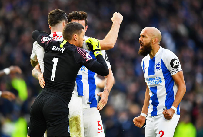 Brighton's Mathew Ryan, Shane Duffy, Lewis Dunk and Bruno Saltor celebrate after the match against Wolverhampton Wanderers