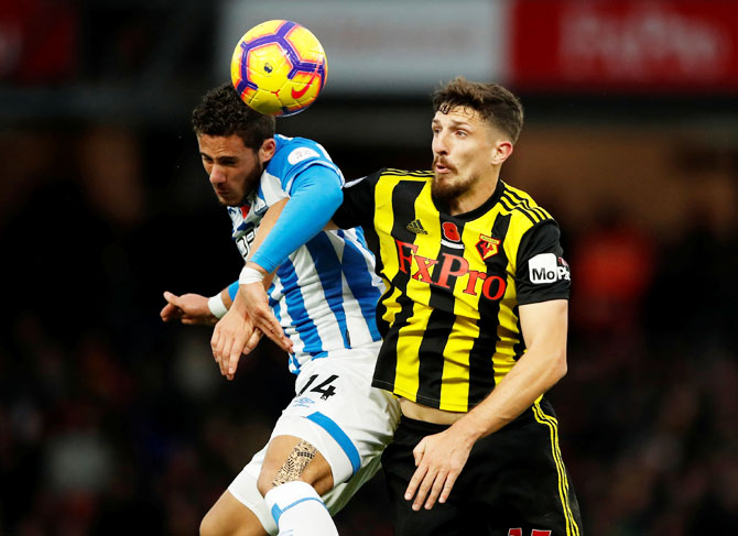 Huddersfield Town's Ramadan Sobhi and Watford's Craig Cathcart vie for possession