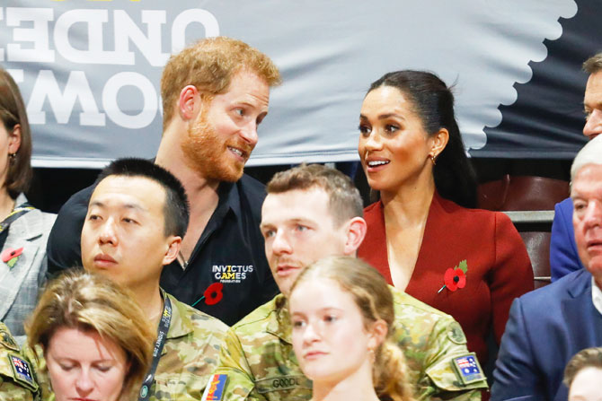 Prince Harry, Duke of Sussex and Meghan, Duchess of Sussex watch Netherlands and United States of America compete in the Wheelchair Basketball Gold medal match on day 8 of the Invictus Games in Sydney on Saturday