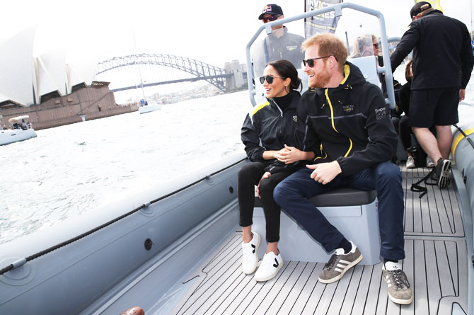 Britain's Prince Harry and Meghan, Duchess of Sussex on Sydney Harbour looking out at Sydney Opera House and Sydney Harbour Bridge on Day 2 of the Invictus Games at Sydney Olympic Park on Sunday, October 21