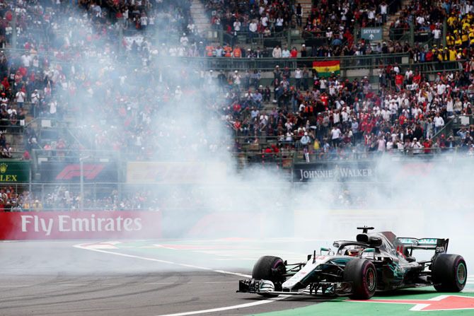 Lewis Hamilton performs donuts as he celebrates winning the 2018 F1 World Drivers Championship on Sunday