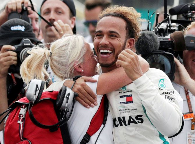 Mercedes' Lewis Hamilton celebrates after winning the World Championship in Mexico on Sunday
