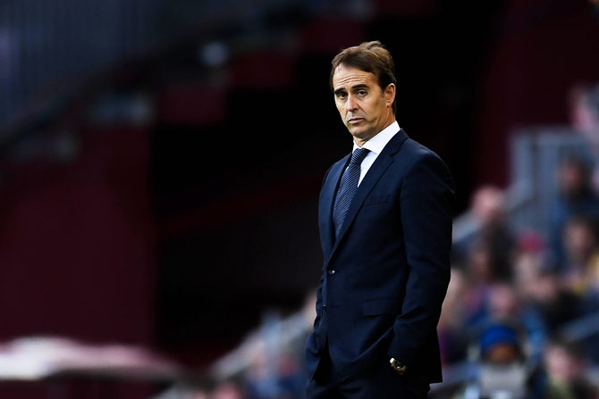 Real Madrid's head coach Julien Lopetegui looks on during the La Liga match between FC Barcelona and Real Madrid CF at Camp Nou on Sunday