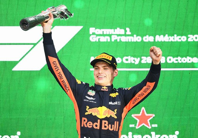 Race winner Max Verstappen of Netherlands and Red Bull Racing celebrates on the podium during the Formula One Grand Prix of Mexico on Sunday