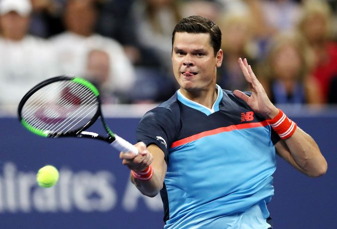Canada's Milos Raonic returns the ball during the men's singles second round match against Stan Wawrinka at the USTA Billie Jean King National Tennis Center on Friday