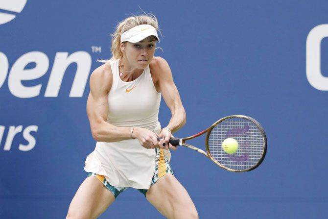 Ukraine's Elina Svitolina hits a backhand against China's Qiang Wang in the third round match