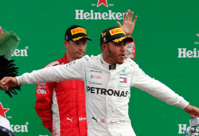 Rediff Sports - Cricket, Indian hockey, Tennis, Football, Chess, Golf - Hamilton wins as Vettel spins in Ferrari's backyard