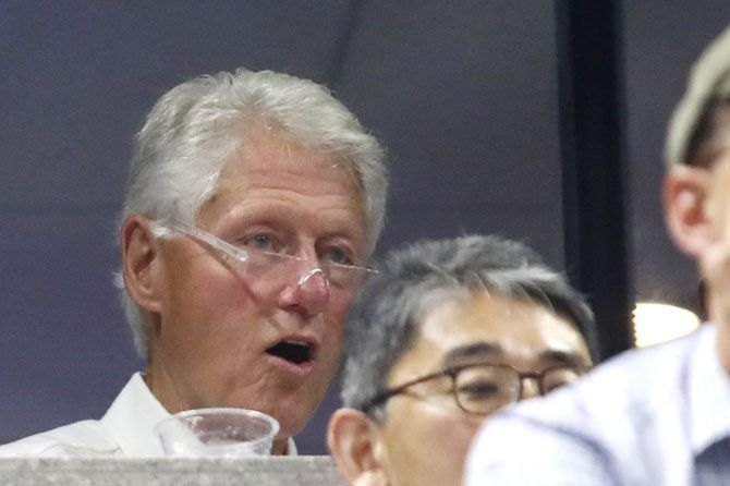 Bill Clinton watches in shock as the proceedings unfold at the USTA Billie Jean King National Tennis Center in New York