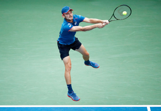 David Goffin plays a return against Marin Cilic