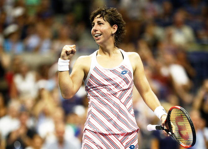 Carla Suarez Nevarro celebrates match point against Maria Sharapova
