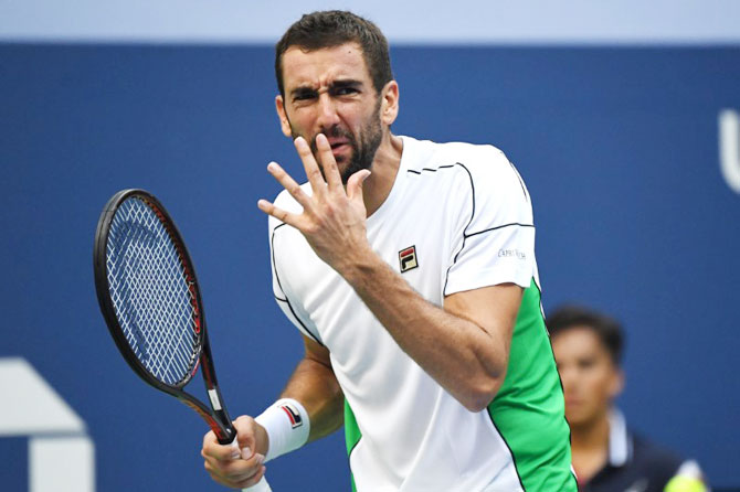 Marin Cilic reacts after losing a point