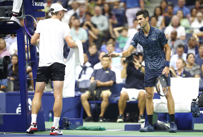 John Millman requests Novak Djokovic to allow him an unscheduled ten minute break during the second set of their men's singles quarter-final on Wednesday