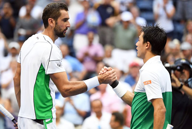 Marin Cilic (left) congratulates and Kei Nishikori after the match
