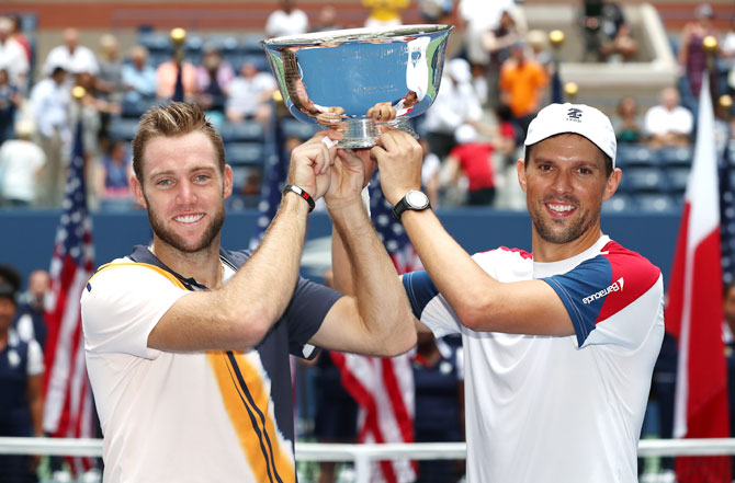 Jack Sock and Mike Bryan of The United States celebrate after beating Lukasz Kubot of Poland and Marcelo Melo of Brazil to win the US Open men's doubles final at the USTA Billie Jean King National Tennis Center on in New York City on Friday