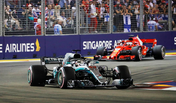 Mercedes' Lewis Hamilton leads during the race at the Singapore F1 GP on Sunday