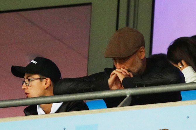 Manchester City manager Pep Guardiola looks dejected in the stands during the match against Olympic Lyon at Etihad Stadium on Wednesday