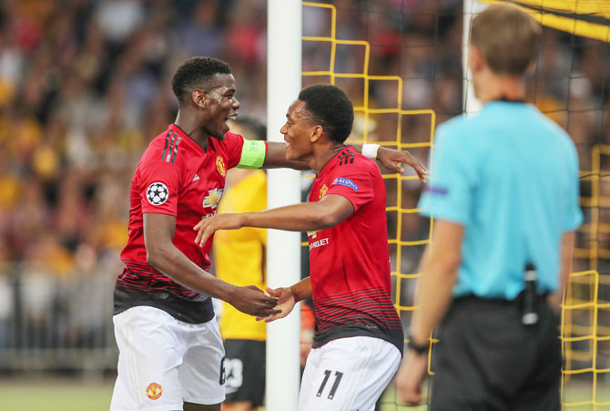 Manchester City's Paul Pogba and Anthony Martial celebrate on scoring a goal against Young Boys during their Champions League match on Wednesday