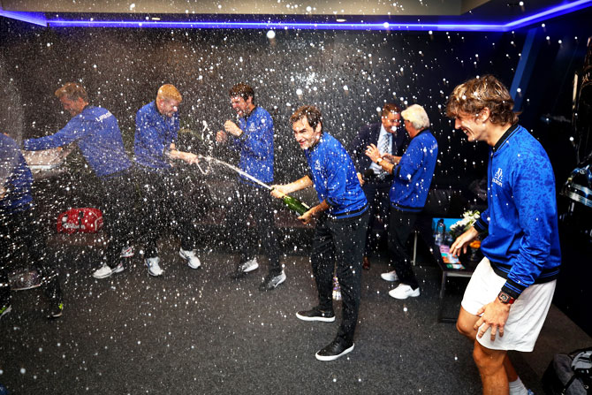 Team Europe Roger Federer's celebrates with his teammates in the locker room after winning the Laver Cup on day three at the United Center in Chicago, Illinois, on Sunday