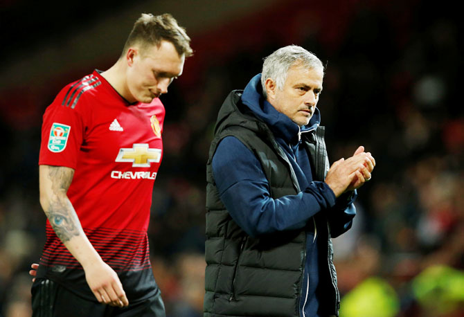 Manchester United's Phil Jones and manager Jose Mourinho wear a dejected look after the match