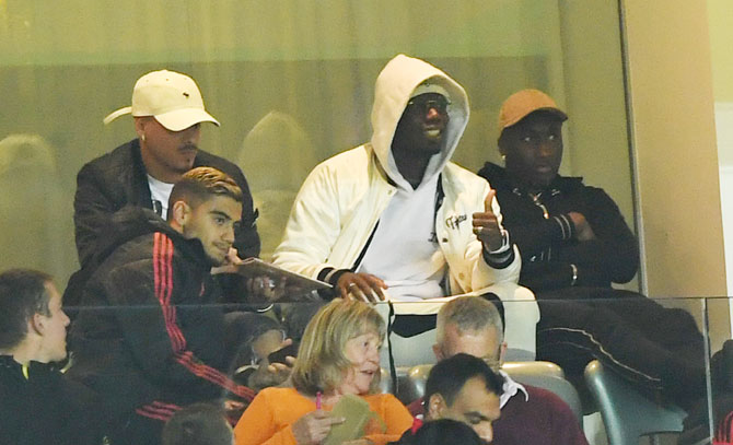 Manchester United's Paul Pogba watches the League Cup Third Round match between Manchester United and Derby County from the stands on Tuesday