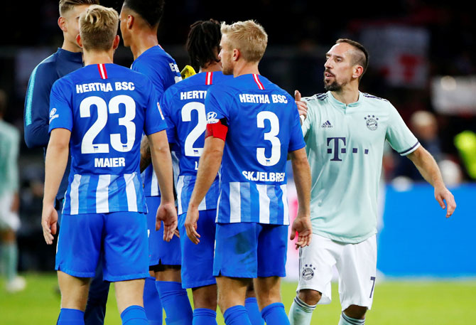 Bayern Munich's Franck Ribery breaks into an argument with Hertha Berlin players after their Bundesliga match at Olympiastadion, Berlin, on Saturday